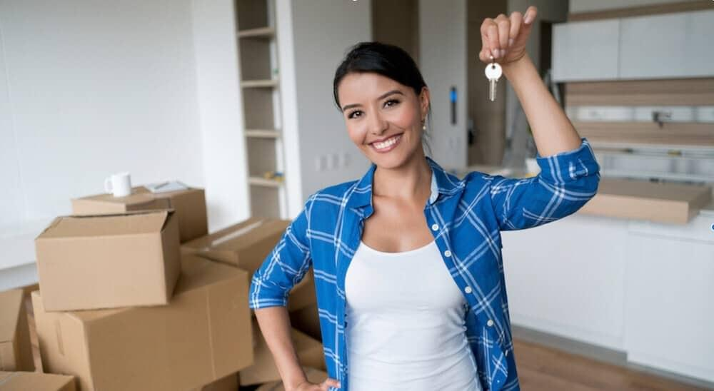 woman holding keys in new house